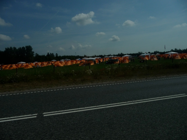 Roskilde Festival is off the hook, its usually about 90,000 people... check out the orange tents in the field as we drive up..